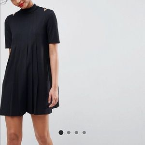 Pleated mini dress with cutout shoulders